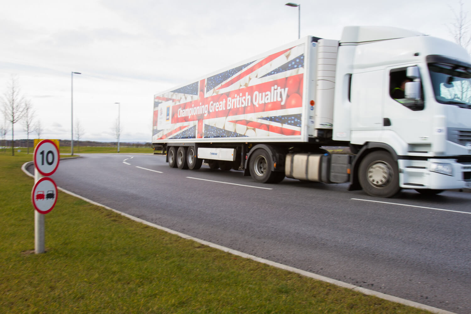 Lorry with British flag on side - 'Championing Great British Quality'