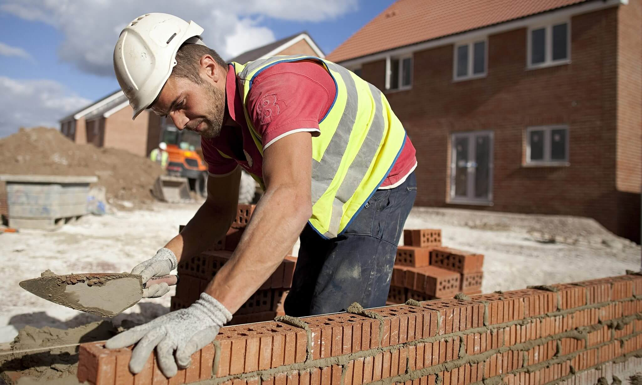 Barnsley business news Safe bet: a builder at a Persimmon construction site for residential housing.